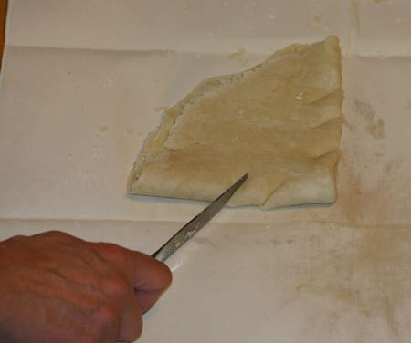 Make 3 slits on each side of dough closer to the point.